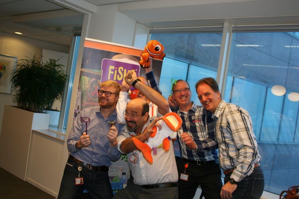 positieve energie tijdens teamtraining FISH bij een bank